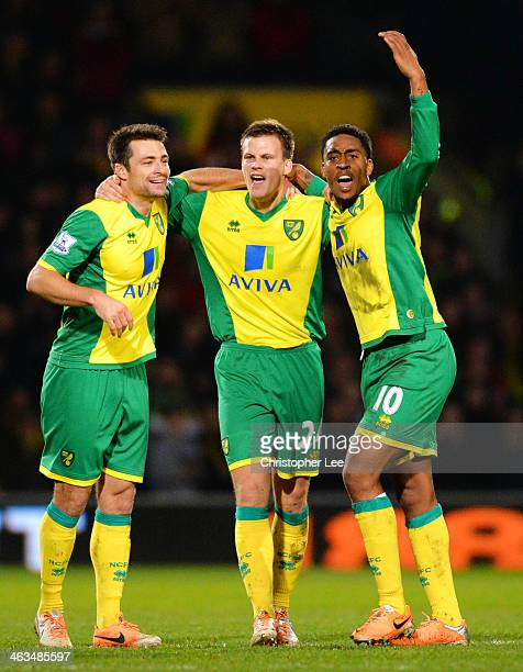 Leroy Fer Sebastien and Russell Martin of Norwich City congratulates Ryan Bennett of Norwich City on scoring their first goal during the Barclays...