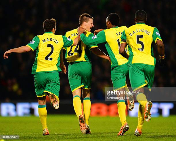 Leroy Fer Sebastien Bassong and Russell Martin of Norwich City congratulate Ryan Bennett of Norwich City on scoring their first goal during the...