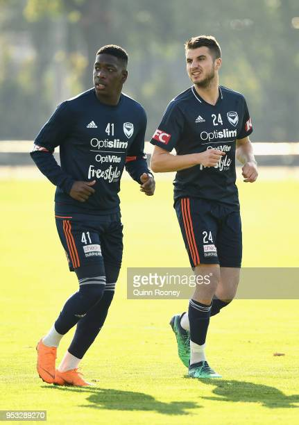 Leroy George and Terry Antonis of the Victory warm up during a Melbourne Victory ALeague training session at Gosch's Paddock on May 1 2018 in...