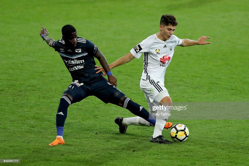 Leroy George of Melbourne Victory and Logan Rogerson of Wellington Phoenix compete for the ball during the round 26 A-League match between the Melbourne Victory and the Wellington Phoenix at AAMI Park on April 8, 2018 in Melbourne, Australia.