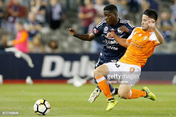 Leroy George of the Victory and Connor O'Toole of the Roar compete during the round six ALeague match between the Melbourne Victory and Brisbane Roar...
