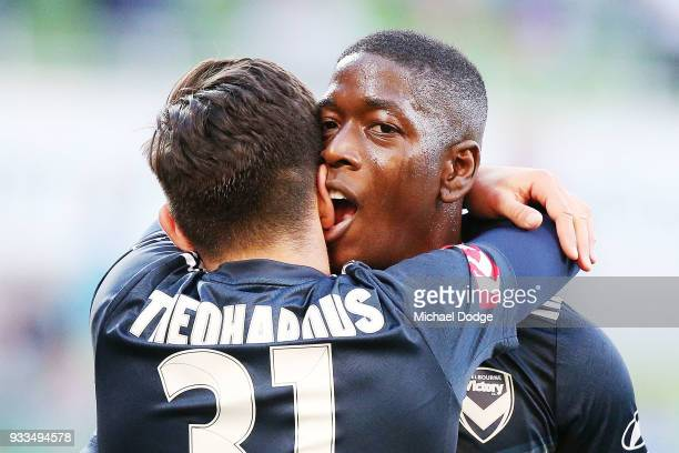 Leroy George of the Victory bites the ear of Christian Theoharous of the Victory after he scored a goal during the round 23 ALeague match between the...
