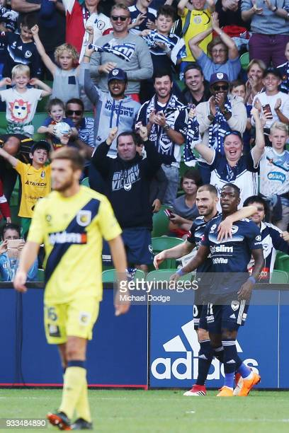Leroy George of the Victory celebrates a goal with James Troisi of the Victory during the round 23 ALeague match between the Melbourne Victory and...