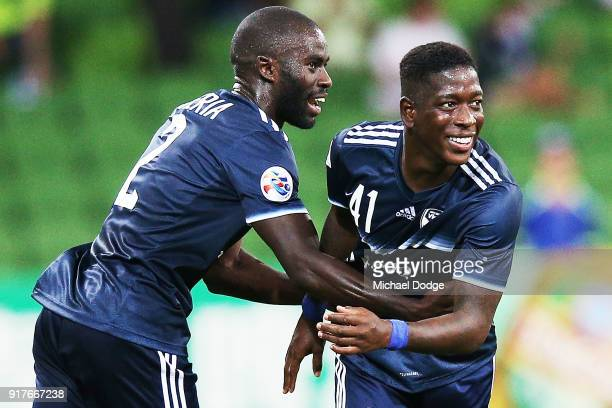 Leroy George of the Victory celebrates a goal with Jason Geria of the Victory during the AFC Asian Champions League match between the Melbourne...