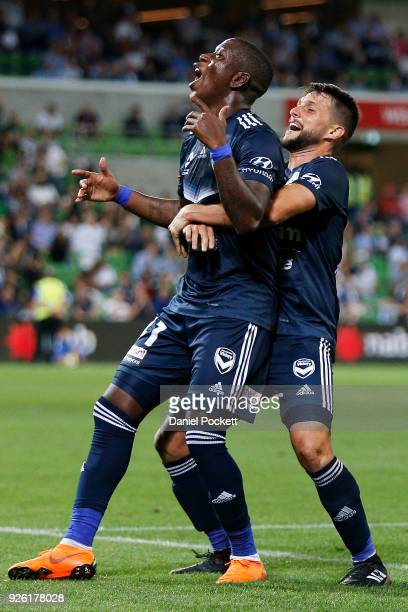 Leroy George of the Victory celebrates after scoring a goal with Mat'as S‡nchez of the Victory during the round 22 ALeague match between Melbourne...