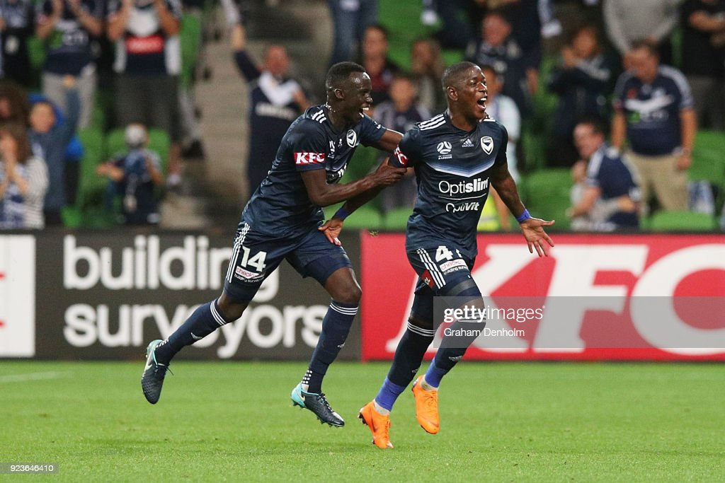 Leroy George of the Victory (R) celebrates his goal during the round 21 A-League match between the Melbourne Victory and Adelaide United at AAMI Park on February 24, 2018 in Melbourne, Australia.
