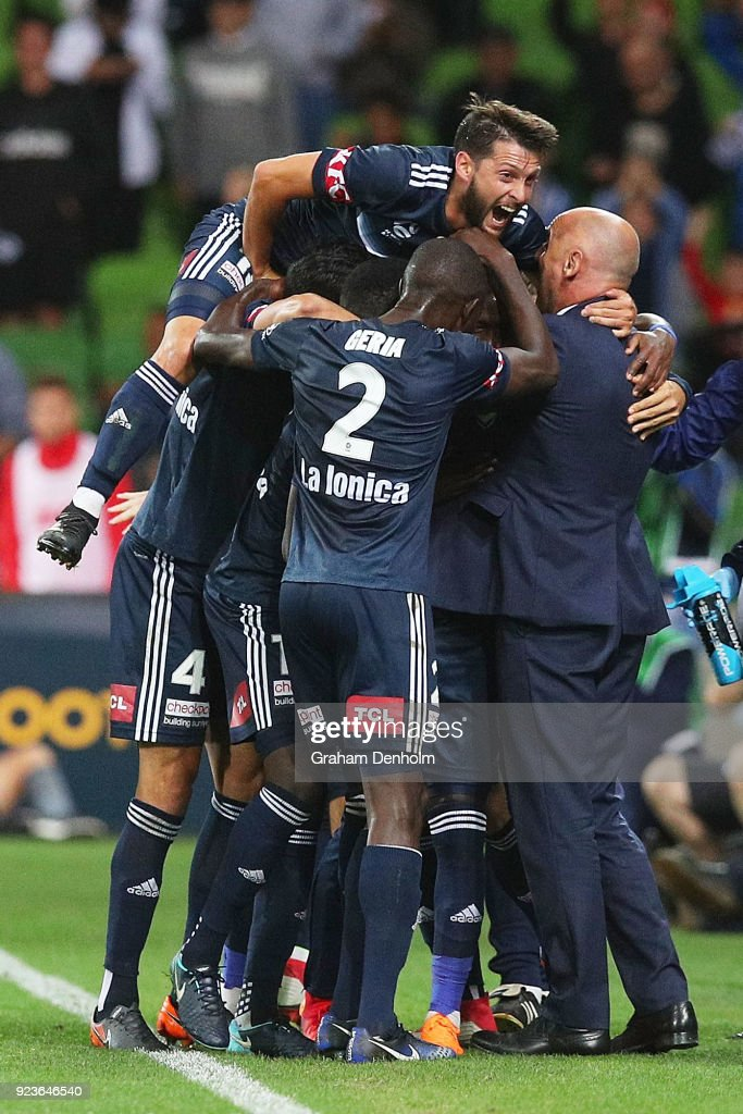 Leroy George of the Victory celebrates his goal with his teammates and Melbourne Victory Head Coach Kevin Muscat (R) during the round 21 A-League match between the Melbourne Victory and Adelaide United at AAMI Park on February 24, 2018 in Melbourne, Australia.