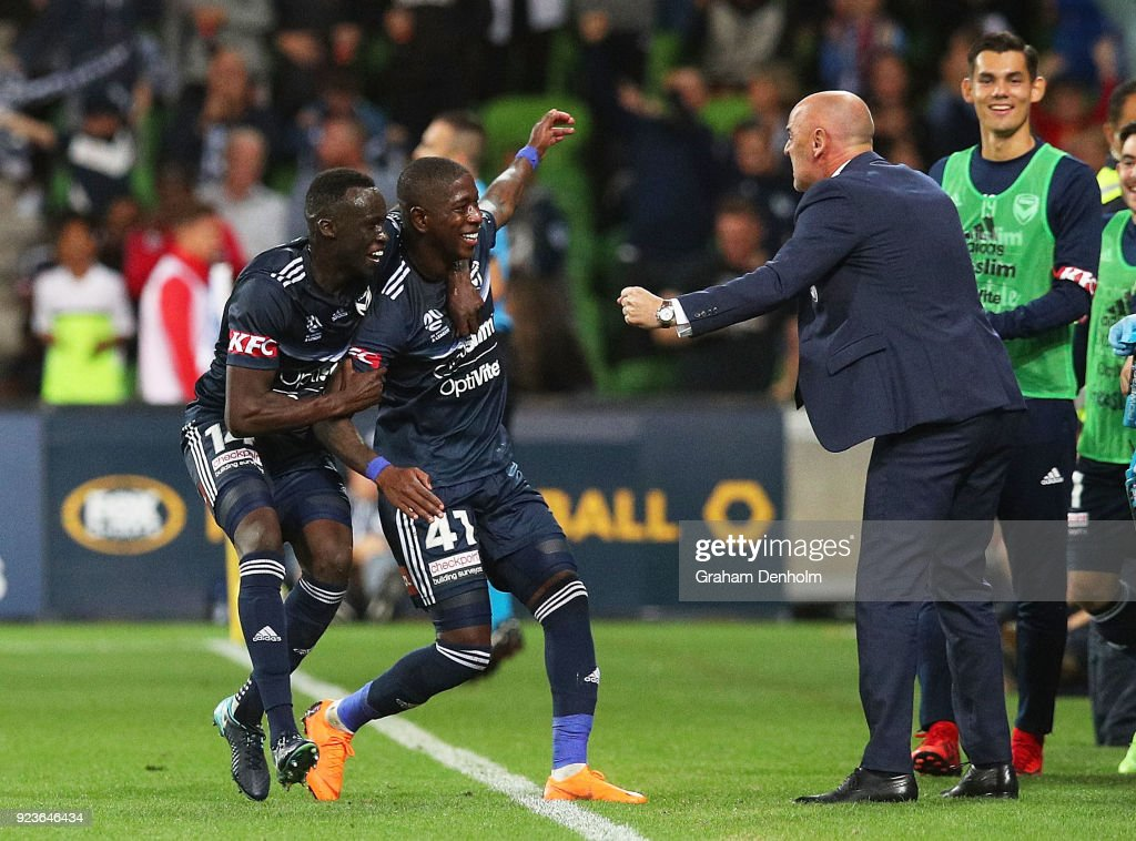 Leroy George of the Victory (C) celebrates his goal with Melbourne Victory Head Coach Kevin Muscat (R) during the round 21 A-League match between the Melbourne Victory and Adelaide United at AAMI Park on February 24, 2018 in Melbourne, Australia.