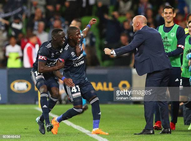 Leroy George of the Victory celebrates his goal with Melbourne Victory Head Coach Kevin Muscat during the round 21 ALeague match between the...