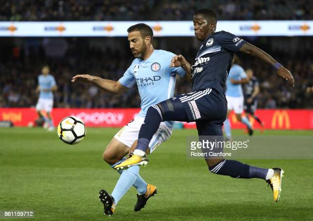 Leroy George of the Victory challenges Manny Muscat of Melbourne City during the round two ALeague match between Melbourne Victory and Melbourne City...
