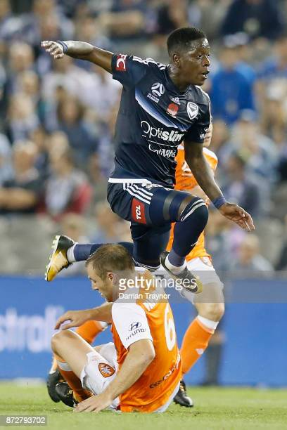 Leroy George of the Victory evades Avraam Papadopoulos of the Roar during the round six ALeague match between the Melbourne Victory and Brisbane Roar...