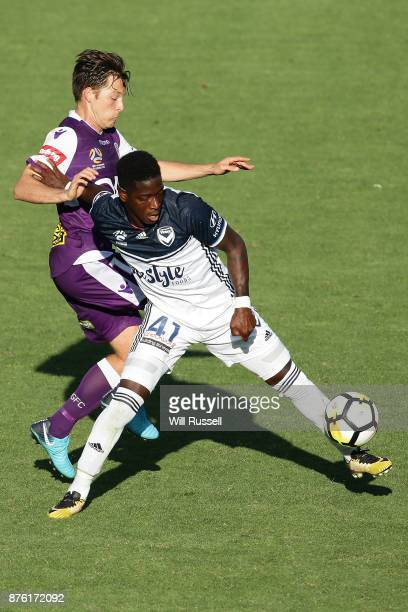Leroy George of the Victory is challenged by during the round seven ALeague match between Perth Glory and Melbourne Victory at nib Stadium on...