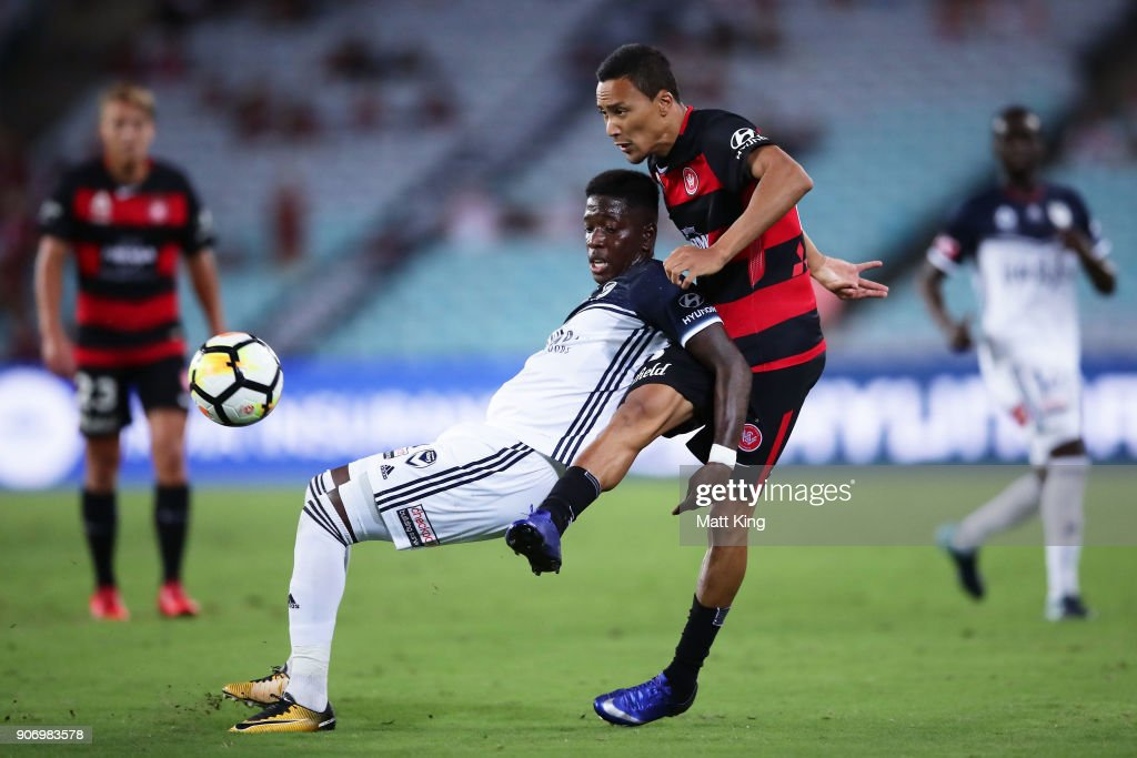 Leroy George of the Victory is challenged by Kearyn Baccus of the Wanderers during the round 17 A-League match between the Western Sydney Wanderers and the Melbourne Victory at ANZ Stadium on January 19, 2018 in Sydney, Australia.
