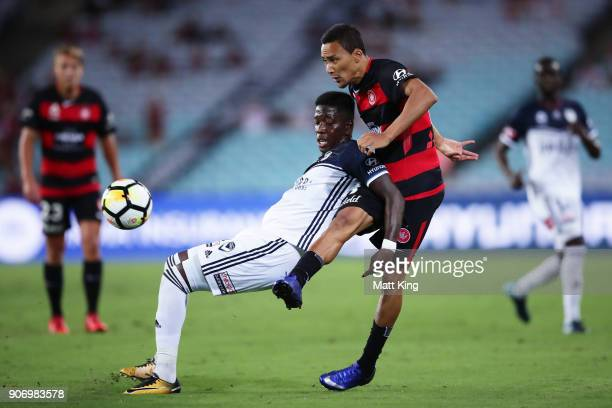 Leroy George of the Victory is challenged by Kearyn Baccus of the Wanderers during the round 17 ALeague match between the Western Sydney Wanderers...