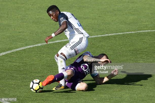 Leroy George of the Victory is tackled by Andy Keogh of the Glory during the round seven ALeague match between Perth Glory and Melbourne Victory at...