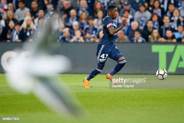 Leroy George of the Victory runs with the ball during the ALeague Elimination Final match between Melbourne Victory and Adelaide United at AAMI Park...