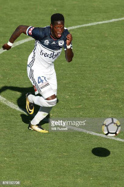 Leroy George of the Victory runs with the ball during the round seven ALeague match between Perth Glory and Melbourne Victory at nib Stadium on...