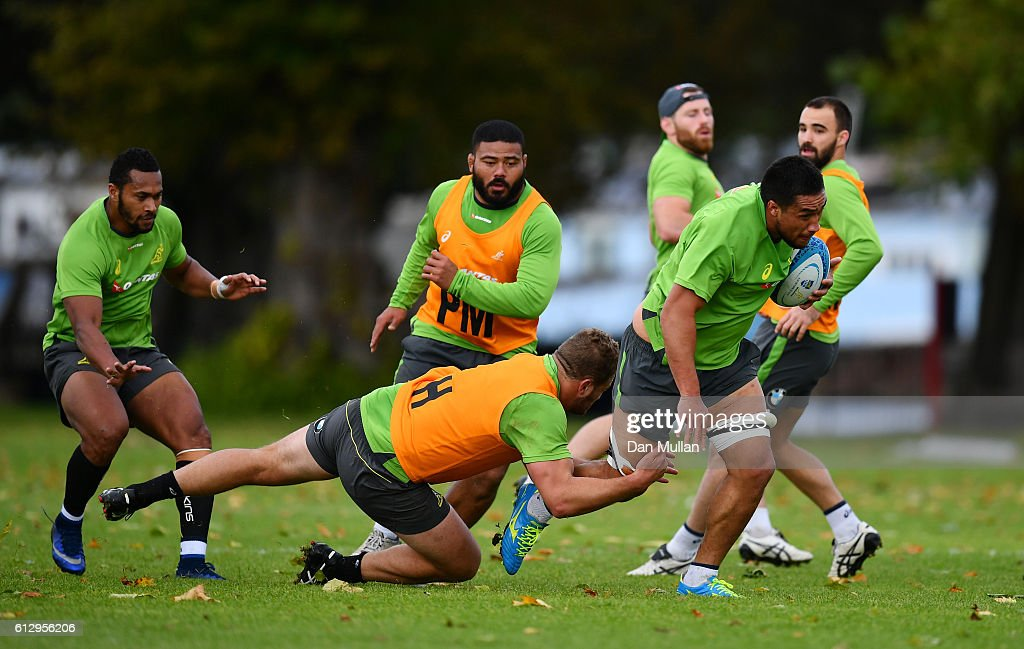 Leroy Houston of Australia is tackled by James Slipper of Australia during an Australia training session at The Lensbury Hotel on October 6, 2016 in London, United Kingdom.