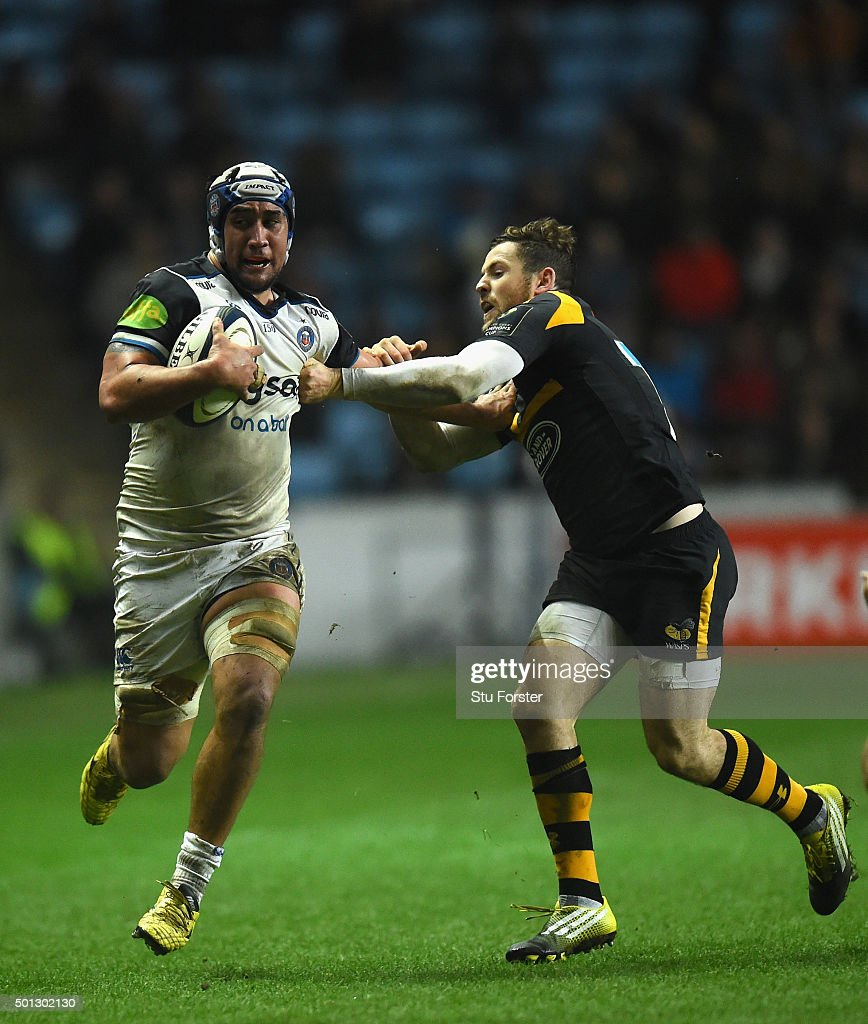 Leroy Houston of Bath is tackled by Elliott Daly of Wasps during the European Rugby Champions Cup match between Wasps and Bath at Ricoh Arena on December 13, 2015 in Coventry, England.