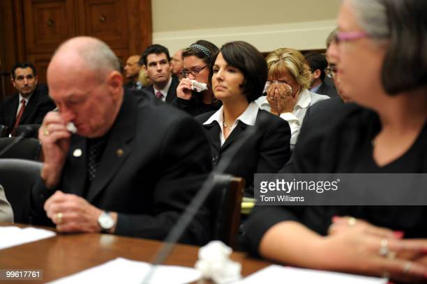 Leroy Hubley left and two women in the audience cry during a House Subcommittee on Oversight and Investigations on the drug Heparin which was...