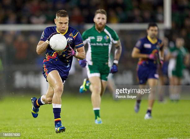 Leroy Jetta of Australia runs with the ball during the International Rules 1st Test between Ireland and Australia at Breffni Park on October 19 2013...