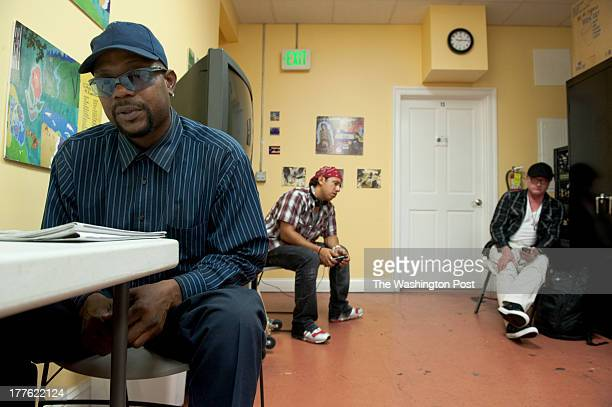 Leroy Lisbon Baltimore Carlos Megron Baltimore and Lewis Sparrow Baltimore wait for day labor jobs at CASA De Maryland job center on July 12 2013 in...