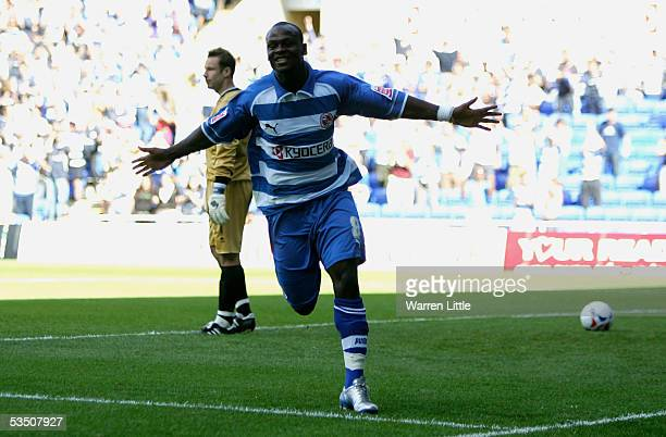 Leroy Lita of Reading celebrates scoring the first goal during the CocaCola Championship match between Reading FC and Burnley FC at the Madejski...