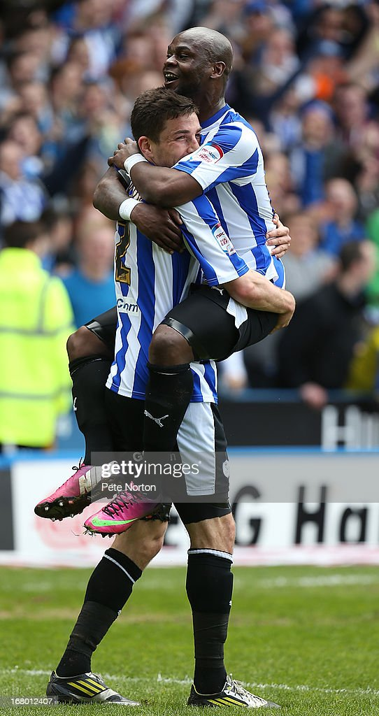 Leroy Lita of Sheffield Wednesday celebrates with team mate Lewis Buxton after scoring his side's 2nd goal during the npower Championship match between Sheffield Wednesday and Middlesbrough at Hillsborough Stadium on May 4, 2013 in Sheffield, England.