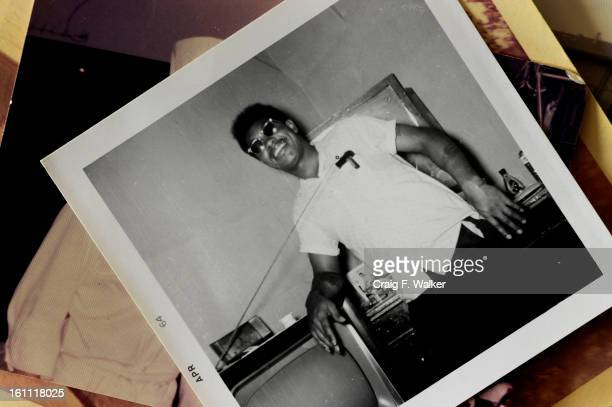 Leroy Oliver Jr displays a 1964 photograph of his father Leroy Oliver Sr at his home in Denver CO Thursday January 27 2011 Oliver Sr died of...