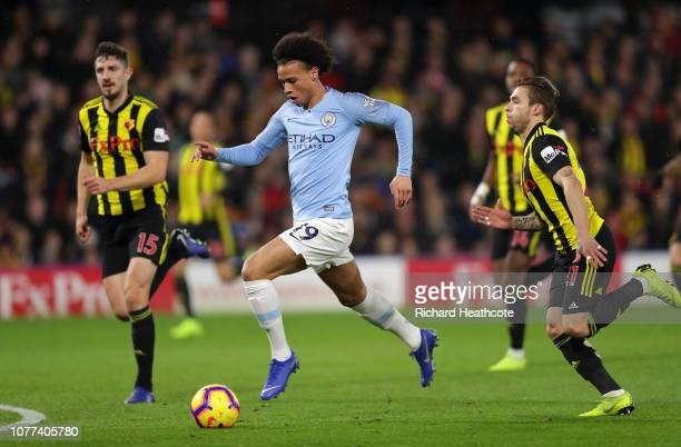 Leroy Sané of Man City goes past Kiko Femenia of Watford during the Premier League match between Watford FC and Manchester City at Vicarage Road on...
