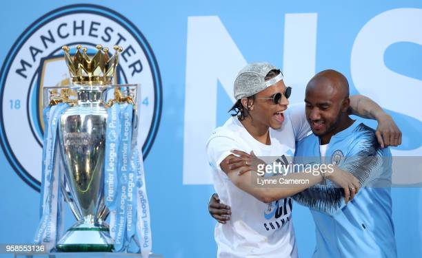 Leroy Sane and Fabian Delph of Manchester City during the Manchester City Trophy Parade in Manchester city centre on May 14 2018 in Manchester England