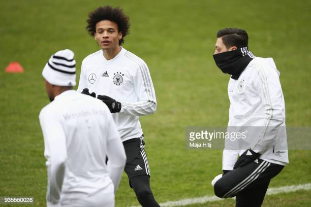 Leroy Sane and Mesut Oezil exercise during a Germany training session ahead of their international friendly match against Spain at PaulJanesStadion...