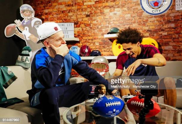 Leroy Sane and Oleksandr Zinchenko of Manchester City take part in a Super Bowl player appearance at Manchester City Football Academy on February 2...