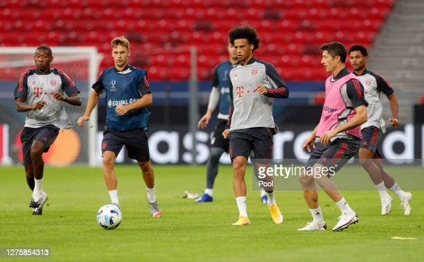 Leroy Sane and Robert Lewandowski of Bayern Munich battle for possession during a training session ahead of their UEFA Super Cup match against...