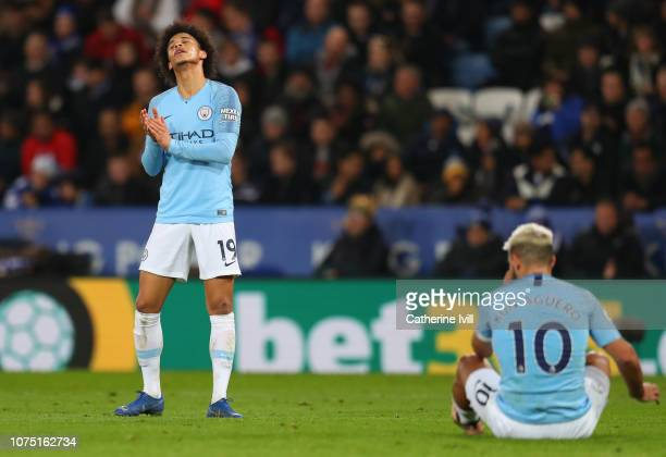 Leroy Sane and Sergio Aguero of Manchester City react during the Premier League match between Leicester City and Manchester City at The King Power...