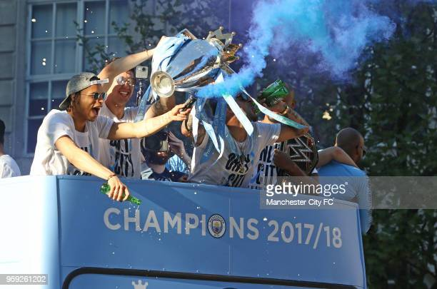 Leroy Sane and teammates enjoy the atmosphere during a victory Parade by Manchester City FC on May 14 2018 in Manchester England