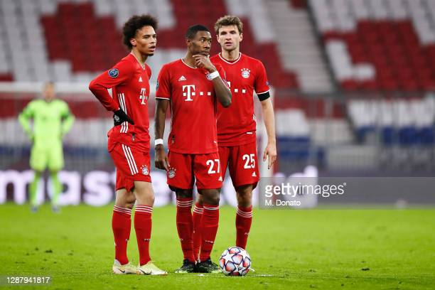 Leroy Sane, David Alaba and Thomas Mueller of FC Bayern Muenchen speak prior a free kick during the UEFA Champions League Group A stage match between...