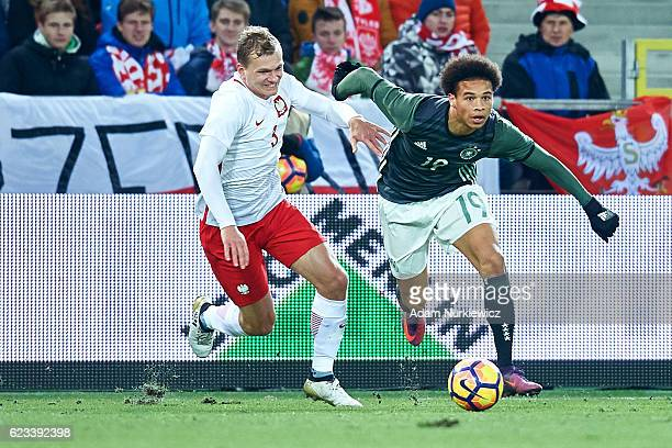Leroy Sane from Germany fights for the ball with Pawel Jaroszynski from Poland during the International Friendly soccer match between Poland U21 and...