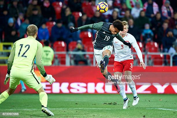 Leroy Sane from Germany shoots on the goal against goalkeeper Jakub Wrabel from Poland during the International Friendly soccer match between Poland...