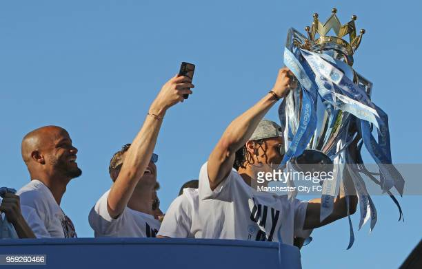 Leroy Sane holds up the Premier League Trophy during a victory Parade by Manchester City FC on May 14 2018 in Manchester England