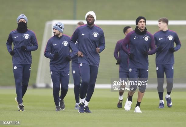 Leroy Sane Ilkay Gundogan Yaya Toure and Claudio Bravo at Manchester City Football Academy on January 10 2018 in Manchester England
