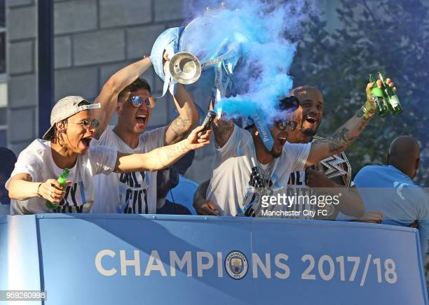 Leroy Sane John Stones Kyle Walker and Vincent Kompany enjoy the atmosphere during a victory Parade by Manchester City FC on May 14 2018 in...