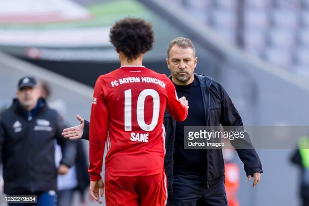 Leroy Sane of Bayern Muenchen and head coach Hansi Flick of Bayern Muenchen look on during the Bundesliga match between FC Bayern Muenchen and 1. FC...