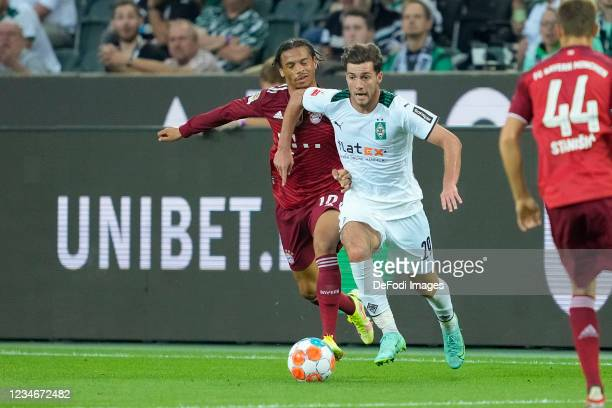 Leroy Sane of Bayern Muenchen and Joe Scally of Borussia Moenchengladbach battle for the ball during the Bundesliga match between Borussia...