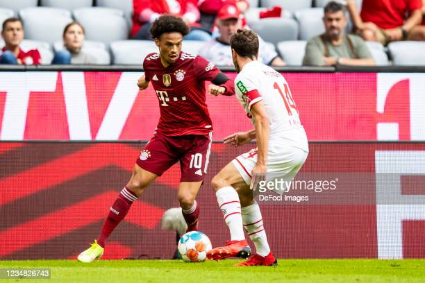 Leroy Sane of Bayern Muenchen and Jonas Hector of 1. FC Koeln battle for the ball during the Bundesliga match between FC Bayern Muenchen and 1. FC...