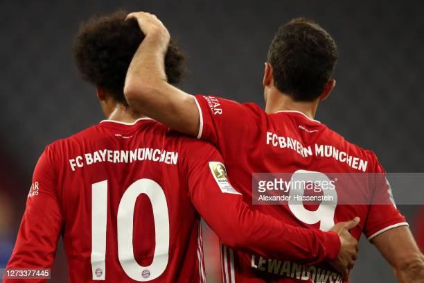 Leroy Sane of Bayern Munich celebrates after he scores his teams seventh goal with Robert Lewandowski during the Bundesliga match between FC Bayern...