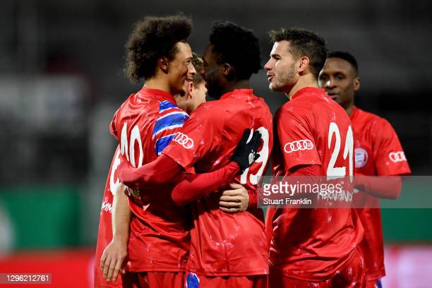 Leroy Sane of Bayern Munich celebrates with teammates Joshua Kimmich, Alphonso Davies and Lucas Hernandez after scoring their team's second goal...