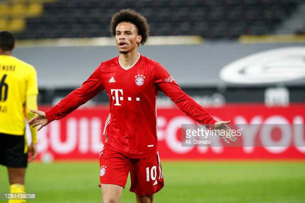 Leroy Sane of FC Bayern Muenchen celebrates after scoring his team's third goal during the Bundesliga match between Borussia Dortmund and FC Bayern...