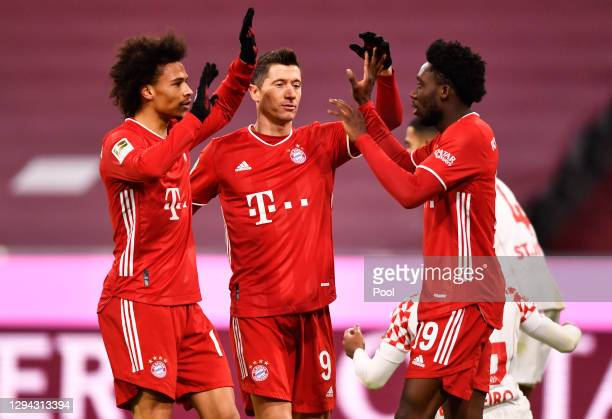 Leroy Sane of FC Bayern Munich celebrates with team mates Robert Lewandowski and Alphonso Davies after their goal that was later disallowed during...