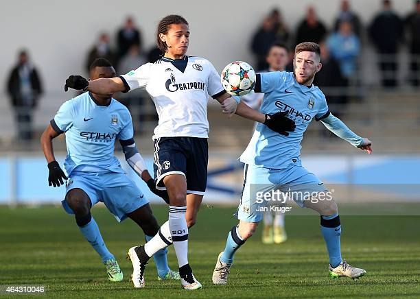 Leroy Sane of FC Schalke 04 battles with Jack Byrne of Manchester City FC during the UEFA Youth League Round of 16 match between Manchester City FC...
